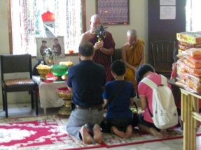 Monks bestowing blessings at Dhammikarama Burmese Temple