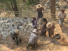 Work gang building wall