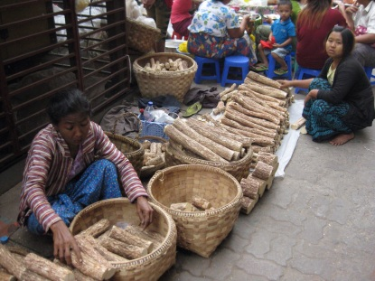 Thanakha seller at market
