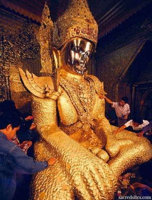 Layering gold leaf on Buddha statue, Maha Myat Muni pagoda