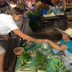 Purchasing lime leaves & galangal to take home!