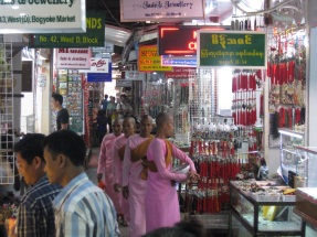 Daughters of Buddha collecting alms in market