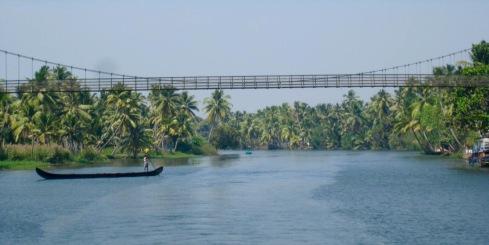 Suspension walking bridge across the waterway