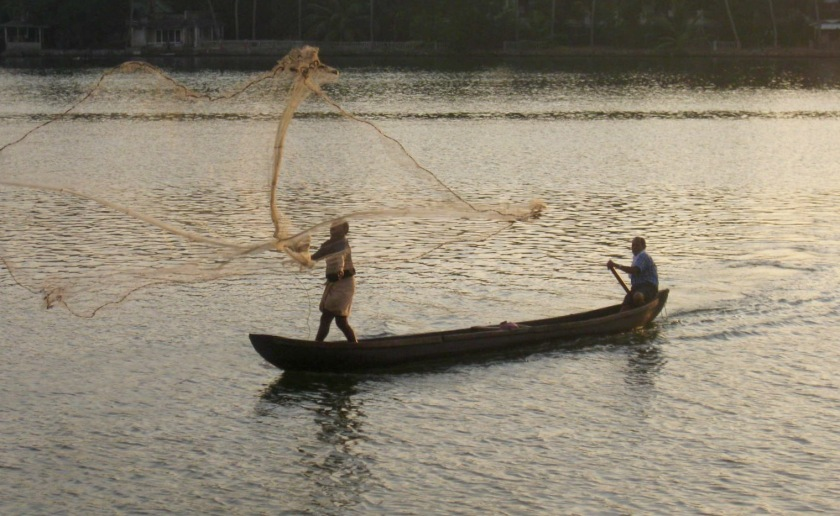 Throwing the fishing net - great pic Bob!