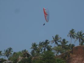 Parasail floating over the cliffs