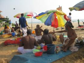 Indian priests on the beach