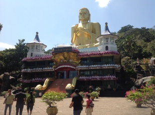 Golden Buddha entrance to caves