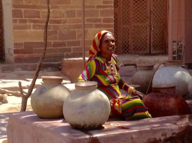 Woman offering water