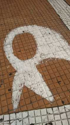 The whet scarf of the Mothers painted on the ground in Plaza de Mayo